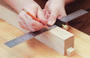 woodworking with tape measure, pencil and ruler