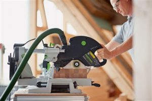 man working with the best double bevel mitre saw